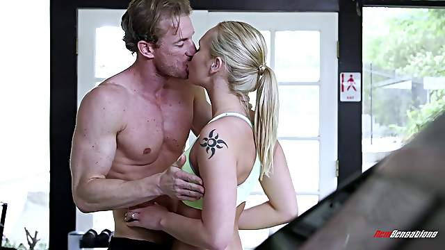 Horny trainer works on dashing blonde's pussy at the gym