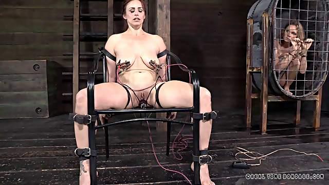 Kinky lady enjoys electric shocks on her pulsating stiff nipples