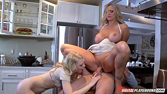 Two blonde friends getting a hard bonking on the wooden table