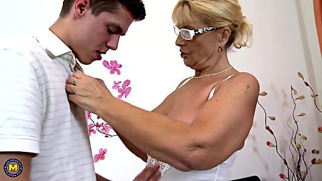Granny Regina T. bouncing on a young stud's throbbing cock