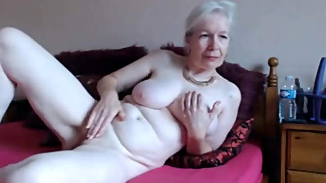Hot granny rubs her pussy in front of a webcam