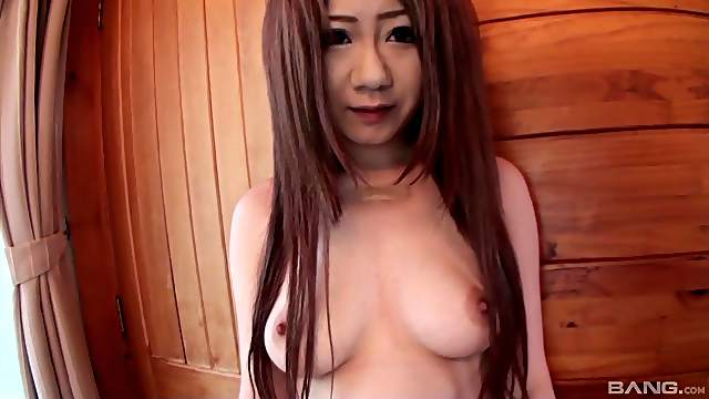 Shy Japanese chick Megu drops on her knees to give a blowjob