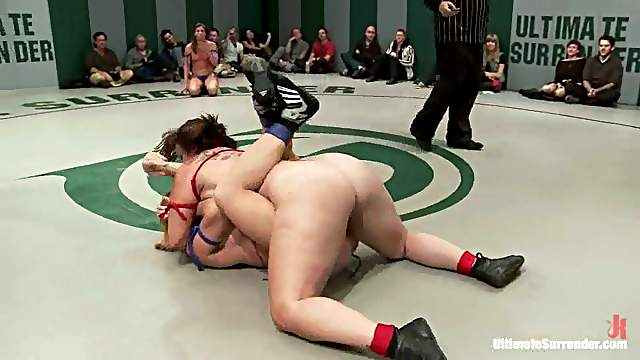 Sizzling lesbians play with each other's holes during a fight on tatami