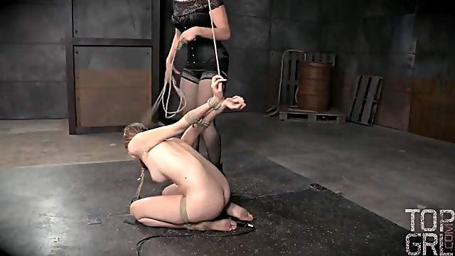 Tied beauty in the dungeon abused by her mistress