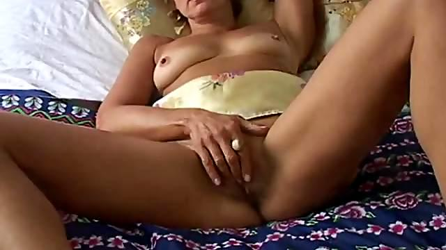 Mom fits four fingers into her wet pussy