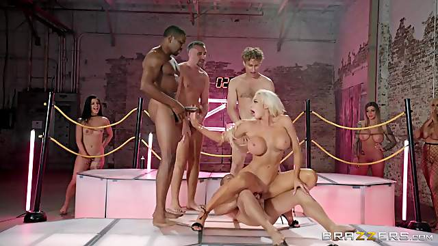 Pornstars take turns getting gangbanged