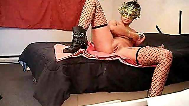 Sexy girl in a mask does squirting masturbation