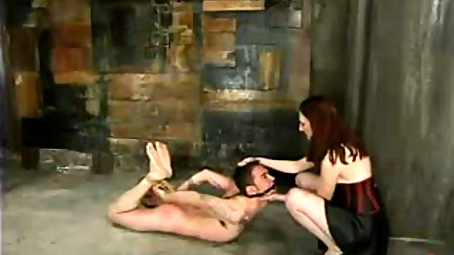 Redhead bitch bends him over and fucks his ass with a strapon