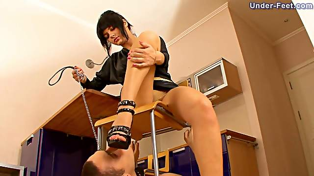 Curvaceous Russian Femdom doll inserting heels in slave mouth