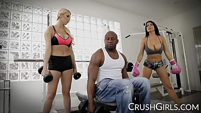 Kenzie and Romi share a big black cock at the gym