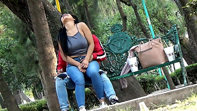 Latina beauty with boyfriend having fun in the park