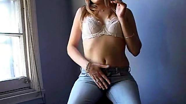 Solo amateur chubby in jeans showcasing her natural tits