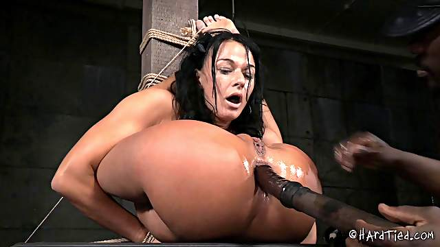 Flexible cutie is tied up and attacked with loads of kinky sex toys