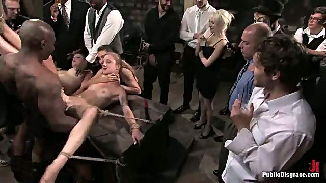 Two sexy girls get tied up, fingered and fucked in public