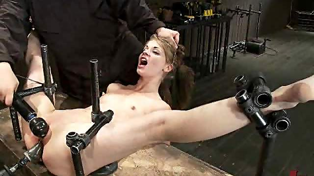 Cute bitch gets fucked by a fucking machine.