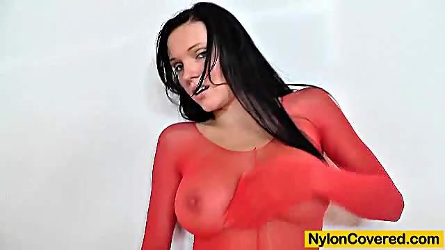 Busty model Ema black face deformed by a nylon mask