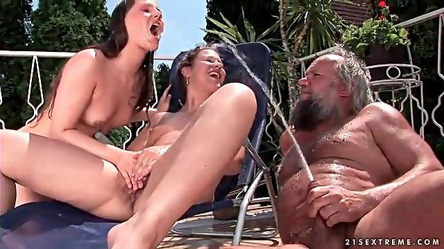 Bikini girls and old guy pissing outdoors