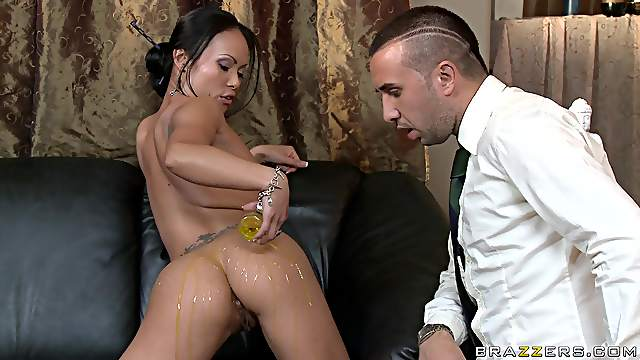 Asian MILF oils her butt for a nasty cock surprise