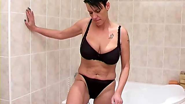 Mom washes tits in the shower