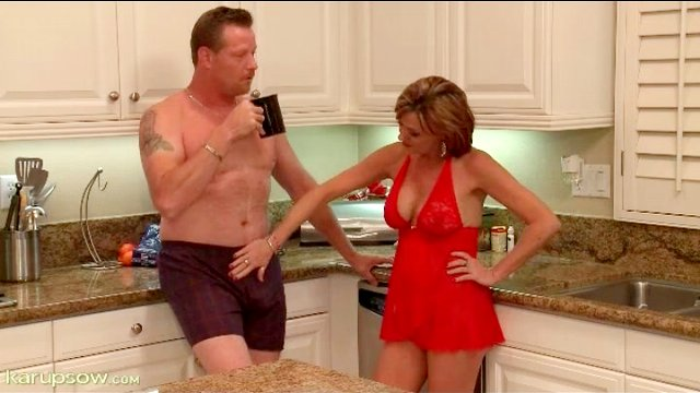 Housewife in lingerie blows her man in kitchen