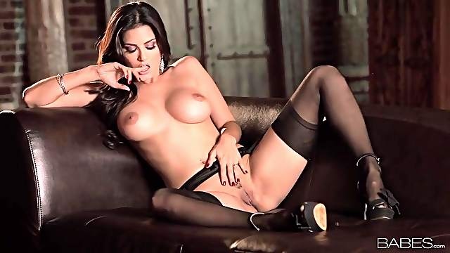Sunny Leone spreads her legs and masturbates in stockings