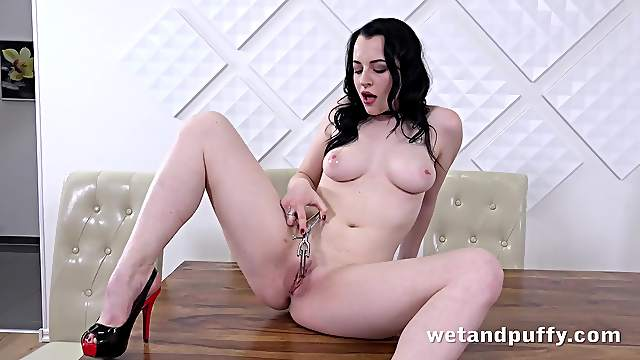 Pale beauty opens her pussy with a speculum