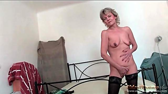 Granny poses in pretty stockings to tease you