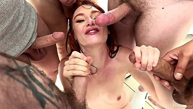 Slutty redhead gang banged in merciless scenes